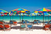 stock photo of recliner  - Camp Bed under the umbrella of colorful  on beach Phuket - JPG