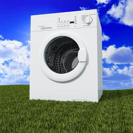 foto of washing machine  - fine 3d washing machine with blue cloudy sky and green grass - JPG