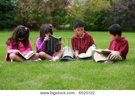 Kids Reading Outside