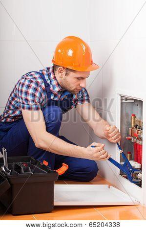 Plumber Repairing Tubes