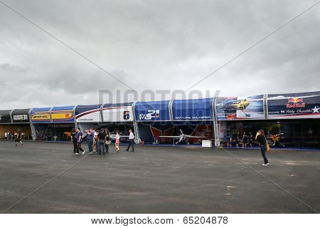 PUTRAJAYA, MALAYSIA - MAY 17, 2014: Early visitors view the planes of the Master Cup pilots parked in the hangars during the Red Bull Air Race World Championship 2014 in Putrajaya, Malaysia.