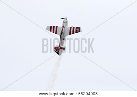 PUTRAJAYA, MALAYSIA - MAY 17, 2014: Paul Bonhomme of Great Britain, in an Edge 540 V2 plane takes to the skies duirng the qualifying session of the Red Bull Air Race World Championship 2014.