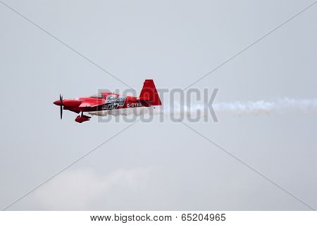 PUTRAJAYA, MALAYSIA - MAY 17, 2014: Pete McLeod of Canada, in an Edge 540 V3 plane takes to the skies of Putrajaya at the qualifying session of the Red Bull Air Race World Championship 2014.
