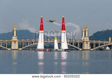 PUTRAJAYA, MALAYSIA - MAY 17, 2014: Nicolas Ivanoff from France flying in an Edge 540 V2 plane enters the race course at the Red Bull Air Race World Championship 2014 in Putrajaya.