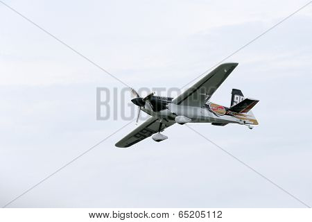 PUTRAJAYA, MALAYSIA - MAY 17, 2014: Michael Goulain from the USA in his Edge 540 V2 plane takes to the skies during the qualifying session of the Red Bull Air Race World Championship 2014.