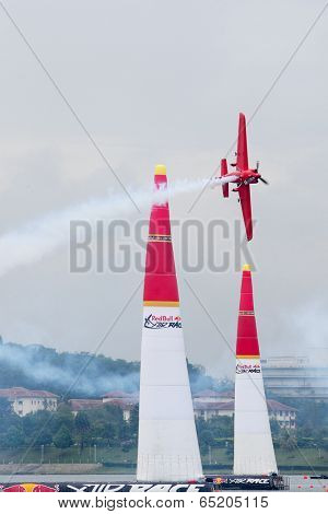 PUTRAJAYA, MALAYSIA - MAY 17, 2014: Pete McLeod from Canada in his Edge 540 V3 plane flies through the race course during the qualifying session of the Red Bull Air Race World Championship 2014.