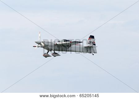 PUTRAJAYA, MALAYSIA - MAY 17, 2014: Matthias Dolderer from Germany flying in an Edge 540 V3 plane flying in the skies of Putrajaya, Malaysia during the Red Bull Air Race World Championship 2014.