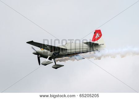 PUTRAJAYA, MALAYSIA - MAY 17, 2014: Yoshihide Muroya from Japan, flying an Edge 540 V2 plane takes to the skies at the qualifying session of the Red Bull Air Race World Championship 2014.