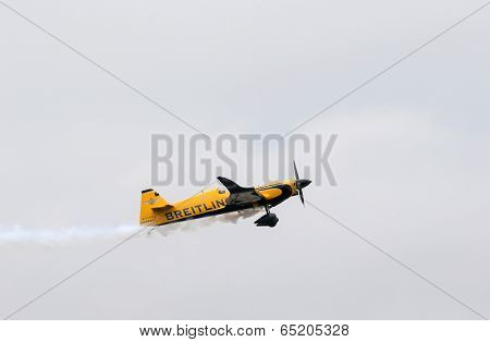 PUTRAJAYA, MALAYSIA - MAY 17, 2014: Nigel Lamb from Great Britain in a MXS-R plane takes to the skies of Putrajaya during the qualifying session of the Red Bull Air Race World Championship 2014.