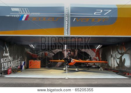 PUTRAJAYA, MALAYSIA - MAY 17, 2014: The Edge 540 V2 plane of Nicolas Ivanoff of France parks at the hangar before the race during the Red Bull Air Race World Championship 2014 in Putrajaya, Malaysia.