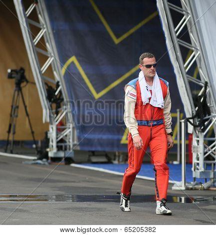 PUTRAJAYA, MALAYSIA - MAY 16, 2014: Pilot Matthias Dolderer of Germany walks back to his hangar after a practice flight preparing for the Red Bull Air Race World Championship Putrajaya 2014.