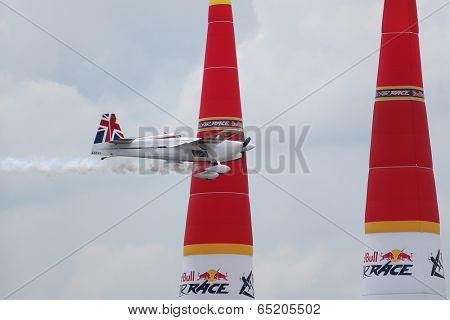 PUTRAJAYA, MALAYSIA - MAY 16, 2014: Paul Bonhomme, UK, flying an Edge 540 v2 plane flies between pylons during a training session preparing for the Red Bull Air Race World Championship Putrajaya 2014.