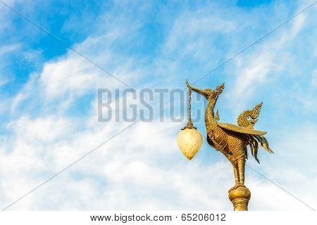 Golden swan on blue sky