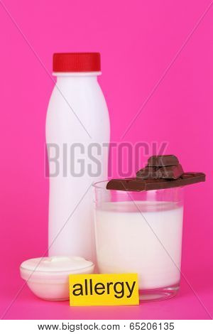 Allergenic food on pink background