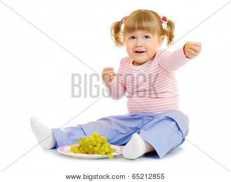 Little girl with grapes isolated