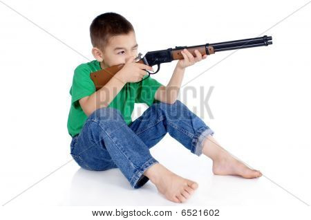 Boy Aiming A Gun