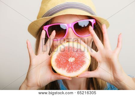 Summer. Girl Tourist Holding Grapefruit Citrus Fruit