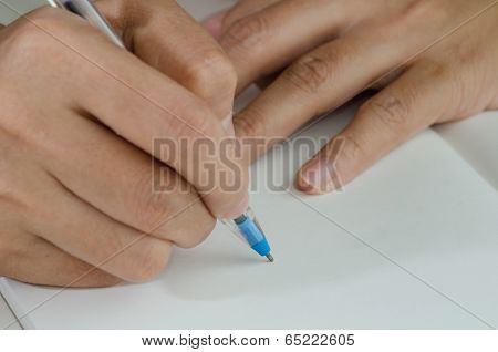 Close-up Of A Woman Drawing Into Her Diary