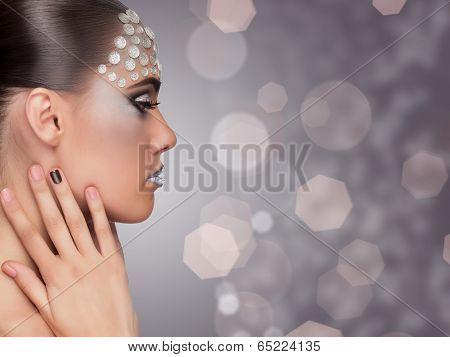 Woman Professional Make Up On Blurry Background