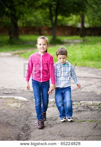 Little Boy And Girl Go For A Walk