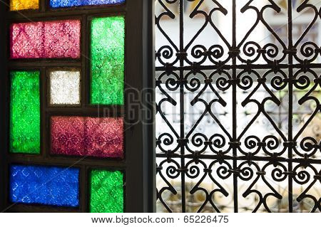 Window With Colored Glass and Arabic Grill In Marrakesh