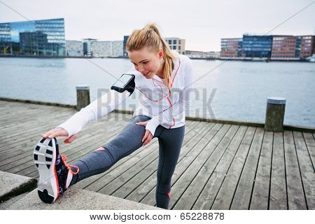 Female Runner Stretching Before A Run