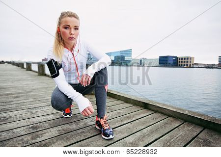 Female Jogger Outdoors Looking Confident