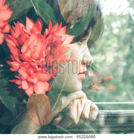Double exposure photograph of attractive girl combined with photograph of flowers