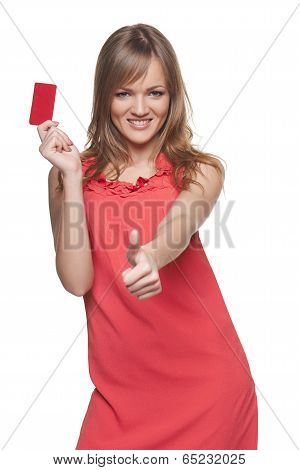 Beautiful fashion woman showing red card
