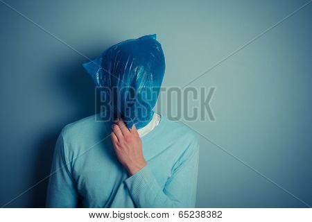 Man With A Plastic Bag Over His Head