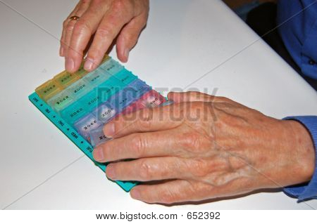 Elderly Hands With Pillbox