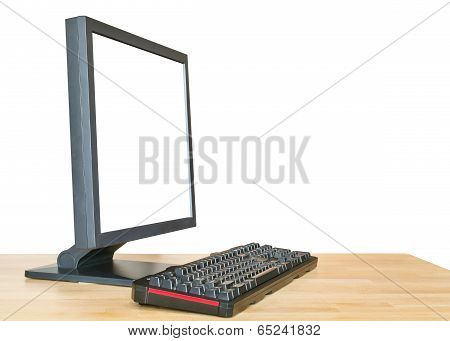 Side View Computer Display And Keyboard On Table