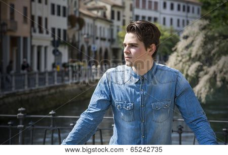 Young Man On City Bridge In Treviso, Italy