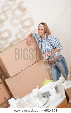 Moving House: Happy Woman With Box