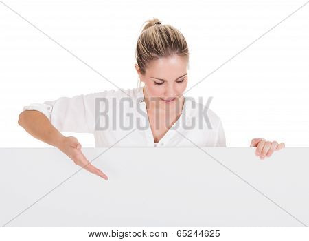 Young Woman Presenting Blank Placard