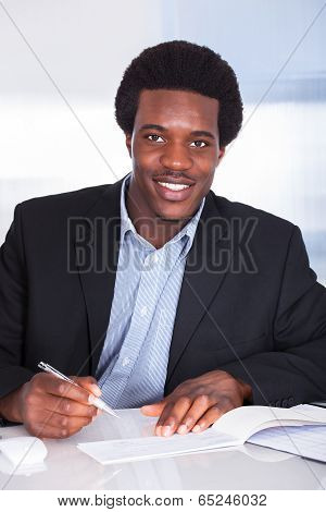 Human Hand Writing On Cheque
