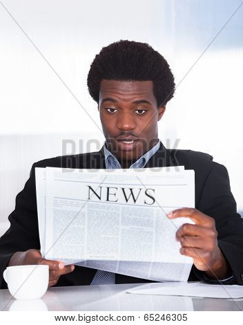 Shocked Businessman Reading Newspaper