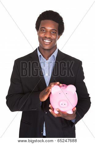 African Businessman Holding Piggybank