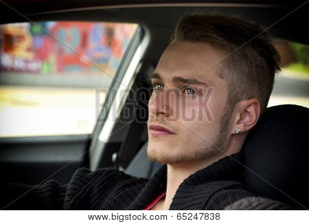 Attractive Young Blond Man Sitting In His Car
