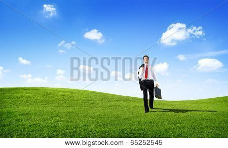 Business Man Walking in the Field