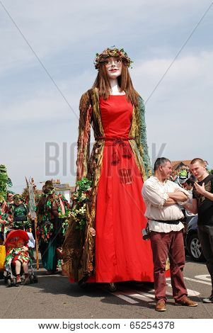 HASTINGS, ENGLAND - MAY 5, 2014: Flora the Singleton Giant is paraded on the West Hill during the annual, May Day, Jack In The Green festival. Pageant Giants are a centuries old tradition in Britain.