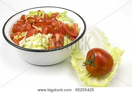 Bowl with salad and tomato