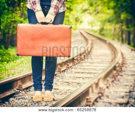 Girl With Retro Suitcase On Railway