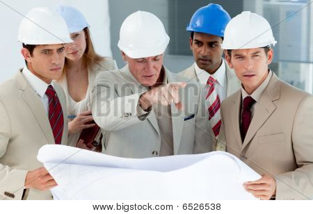 Multi-ethnic Engineers Studying Plans