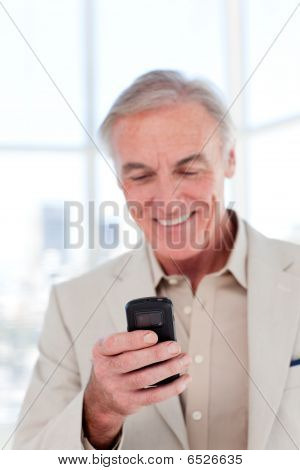 Senior Manager Sending A Text