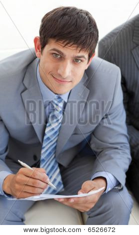 Smiling Businessman In A Waiting Room