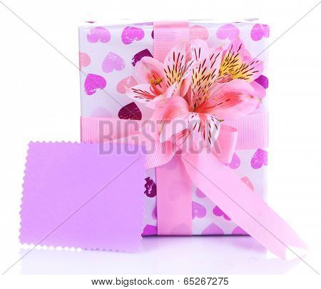 Pink gift with bow and flower isolated on white