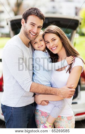 Happy family with car on background