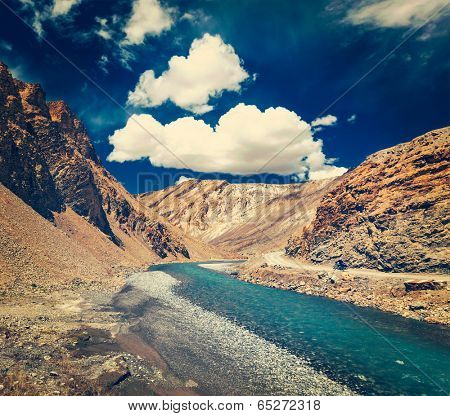 Vintage retro effect filtered hipster style travel image of Himalayan landscape in Hiamalayas near Baralacha La pass. Himachal Pradesh, India