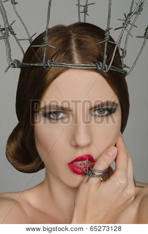 Portrait Woman In Crown And Ring Of Barbed Wire